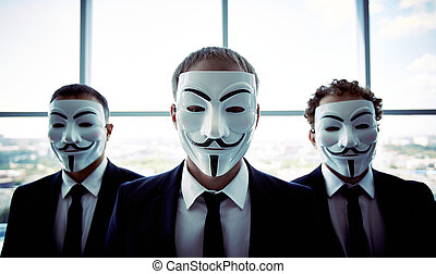 Portrait of three business people wearing anonymous masks
