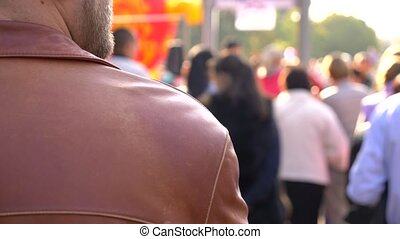 Anonymous crowd of people walking on the street. 4k slow motion