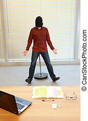 man in black sack on head sitting on pneumatic stool in office