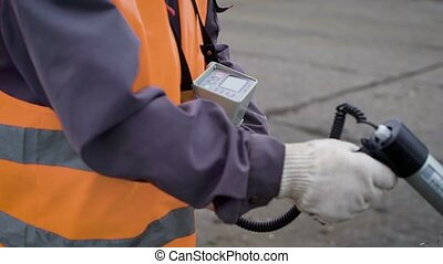 Anonymous man using special warning device to check...