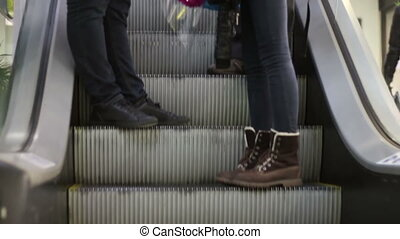 Anonymous People Walking on the EscalatorLift in Shopping Mall