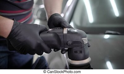 Anonymous person in black gloves holding grinder machine - ...