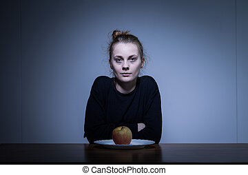 Anorectic girl and apple