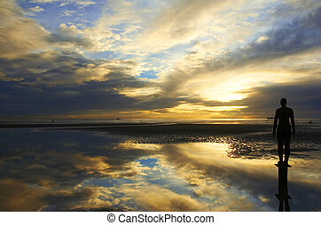 Another Place by Antony Gormley on Crosby Beach. With a...