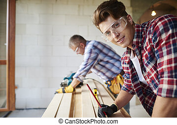 Another snapshot of hard working carpenters