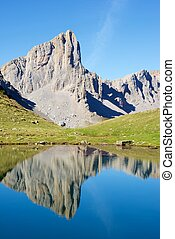 Pyrenees - Ansabere Aiguilles reflected in Ansabere Lake. ...