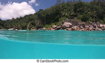 anse Georgette beach split view - Split view underwater of...