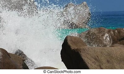 Anse Georgette waves - SLOW MOTION: splashing waves against...