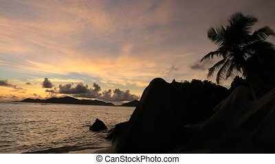 Anse Source d'Argent at dusk - Dramatic colorful sky at...
