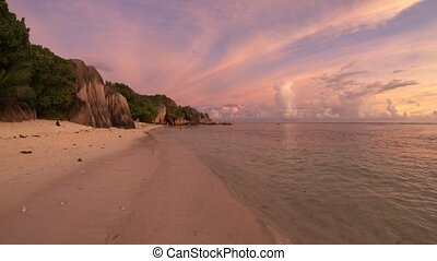 Anse Source d'Argent at dusk - Dramatic colorful sky dusk at...