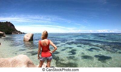 Anse Source d'Argent top view - SLOW MOTION: Tourist woman...