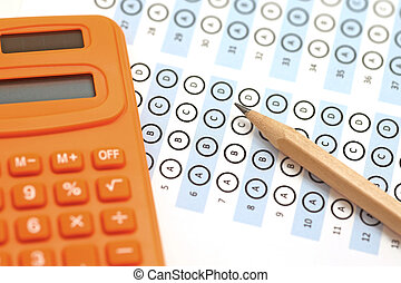answer sheet test score with pencil and calculator