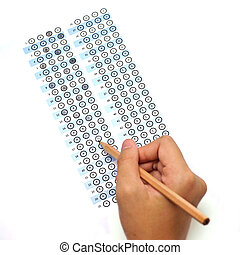 answer sheet test score with pencil and human hand