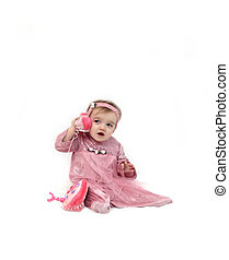 Answering her telephone - Baby girl answers a play...