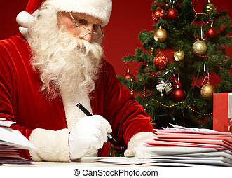 Answering letters - Portrait of Santa Claus answering...