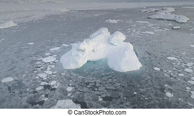 Antarctic glacier iceberg aerial zoom out view - Melting...