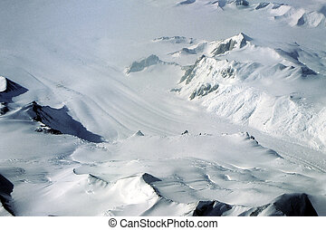 Antarctic Glacier - Mountains are almost buried by the ...