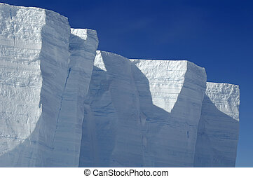 Antarctic ice shelf edge in sunlight