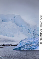 Antarctic Iceberg in blue mist