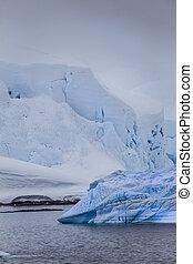 Antarctic Iceberg in blue mist
