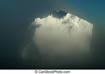 Antarctic iceberg in morning mists