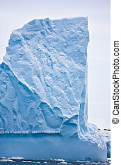 Antarctic iceberg in the snow. Beautiful winter background.
