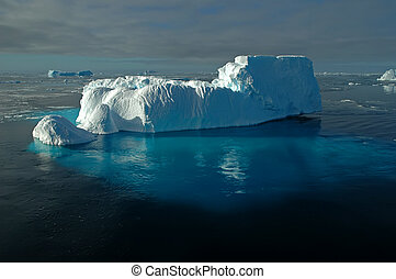 Antarctic iceberg with underwater ice - A foot-shaped...