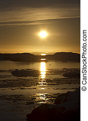 Antarctic icebergs and islands in the setting of the spring sun