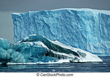 Antarctic icebergs - A larger blue iceberg in the background...