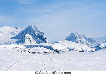 Antarctic mountain range - Mountain range is covered with...