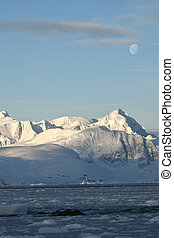 Antarctic mountains under the moonlight on a summer.