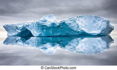 Antarctic Nature. Huge iceberg float in open ocean -...