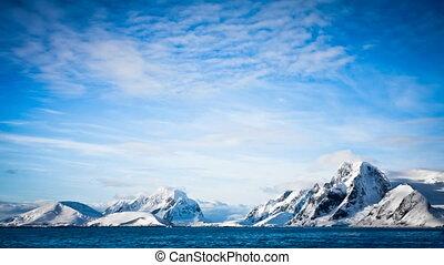 Antarctic Nature. Snow-capped mountains in ocean - Antarctic...