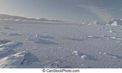 Antarctic ocean coast frozen brash ice aerial shot -...