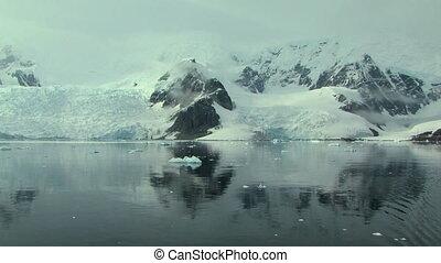 antarctic peninsula reflected in the ocean