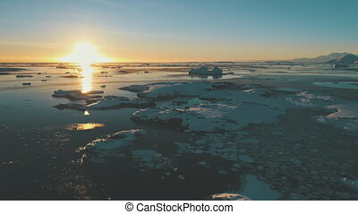 Antarctic sunset over the ocean. Aerial shot. - Sunset, ice...