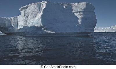 Antarctica aerial flight over the ocean to iceberg