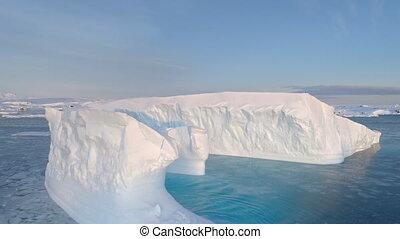 Antarctica big iceberg float aerial tracking view -...