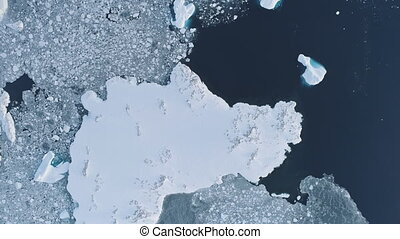 Antarctica iceberg aerial top down flight view
