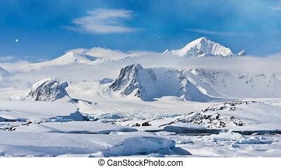 Antarctica Nature. Snow-capped mountain range against blue...