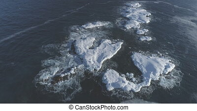 Antarctica Ocean Open Water Rock Aerial View. North Antarctic Brash Ice Glacier Seascape Island Overview. Global Warming Nature Coast Drone Flight Footage Shot in 4K (UHD)