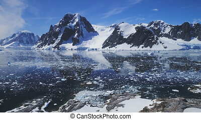 Antarctica ocean, snow mounts. Aerial flight. - Aerial...