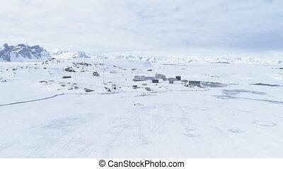 Antarctica penguins, Vernadsky base. Aerial shot. - Aerial...