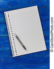 anteckningsblock, på, a, blå, trä tabell