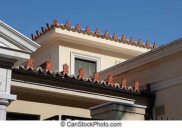 Antefixes, traditional carved ornaments