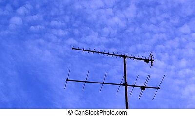 Antenna and clouds timelapse - Timelapse of clouds on blue...