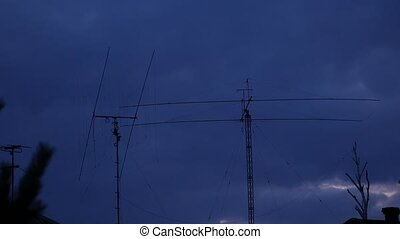 Antenna of amateur radio on a dark blue sky background