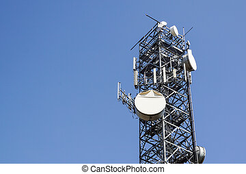 Antenna tower, antenna tower building with the blue sky. Close-up of the antenna building with the sky background.