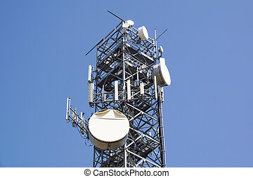 Antenna tower,antenna tower building with the blue sky. Close-up of the antenna building with the sky background.