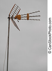 Antennas on a Roof over Cloudy Sky - Antennas on Roof over a...
